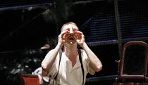 THE NOSE   by Dimitri Shostakovich   conductor: Patrick Bailey   director: John Fulljames,Kovalyov tries to refit his nose: Jeremy Huw Williams (Kovalyov),The Opera Group / Brighton Festival / Brighto...