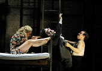 'LADY MACBETH OF MTSENSK' (Shostakovich)~Katerina and Sergei kill her husband, Zinovy~l-r:Vivian Tierney (Katerina Ismailova), Rhys Meirion (Zinovy Ismailova), Robert Brubaker (Sergei)~English Nationa...