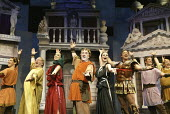 'A FUNNY THING HAPPENED ON THE WAY TO THE FORUM' (Shevelove/Gelbart/Sondheim - director: Edward Hall)~opening number - 2nd left: Sam Kelly (Senex)   centre: Desmond Barrit (Prologus)   3rd from right:...