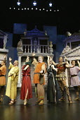 'A FUNNY THING HAPPENED ON THE WAY TO THE FORUM' (Shevelove/Gelbart/Sondheim - director: Edward Hall)~opening number - 2nd left: Sam Kelly (Senex)   centre: Desmond Barrit (Prologus)   2nd from right:...