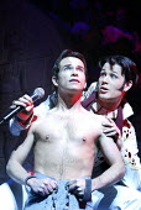 'JOSEPH AND THE AMAZING TECHNICOLOR DREAMCOAT' (Rice/Lloyd Webber)~l-r: Stephen Gately (Joseph), Trevor Jary (Pharaoh/Simeon)~New London Theatre, WC2                      03/03/2003