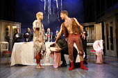 THE TAMING OF THE SHREW   by Shakespeare   director: Edward Hall <br>,front, l-r: Simon Scardifield (Katharine), Dugald Bruce-Lockhart (Petruchio),Propeller / Old Vic Theatre, London SE1...