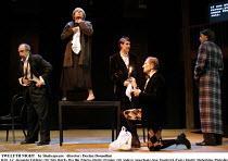 TWELFTH NIGHT   by Shakespeare   director: Declan Donnellan <br>,II/iii - l-r: Alexander Feklistov (Sir Toby Belch), Ilya Ilin (Maria), Dmitry Dyuzhev (Sir Andrew Aguecheek), Igor Yasulovich (Feste),...
