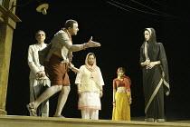'TWELFTH NIGHT' (Shakespeare - director: Stephen Beresford)~left rear: Paul Bhattacharjee (Malvolio)   front: Kulvinder Ghir (Feste)   right: Neha Dubey (Olivia)~Albery Theatre, London WC2...