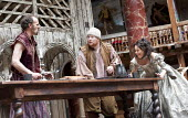 THE TAMING OF THE SHREW   by Shakespeare   design: Mike Britton   director: Toby Frow ~IV/i - l-r: Simon Paisley Day (Petruchio), Chris Keegan (Nathaniel), Samantha Spiro (Katherina) ~Shakespeare's Gl...