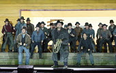 LA FANCIULLA DEL WEST (THE GOLDEN GIRL OF THE WEST)   by Puccini   conductor: Keri-Lynn Wilson   set design: Miriam Buether   costumes: Nicky Gillibrand   lighting: Mimi Jordan Sherin   choreographer:...