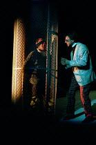 TWELFTH NIGHT by Shakespeare design: Huntley/Muir lighting: Alan Burrett director: David Pountney Malvolio imprisoned - l-r: Richard Durden (Malvolio), Brian Capron (Feste)Nottingham Playhouse, Nottin...