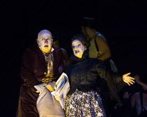 Martin Winkler (Platon Kuzmitch Kovalov), Helene Schneiderman (Respectable Lady) in THE NOSE by Shostakovich opening at the The Royal Opera, Covent Garden, London WC2 on 20/10/2016 ~music: Dmitry Shos...