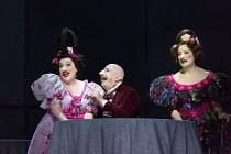 l-r: Ailish Tynan (Podtotshina's daughter ), Martin Winkler (Platon Kuzmitch Kovalov), Helene Schneiderman (Pelageya Grigoryevna Podtotshina) in THE NOSE by Shostakovich opening at the The Royal Opera...