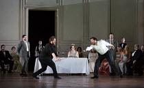 front, duelling - l-r: Allan Clayton (Hamlet), David Butt Philip (Laertes)  watching, rear, l-r: Rupert Enticknap (Rosencrantz), Sarah Connolly (Gertrude), Christopher Lowrey (Guildenstern) in HAMLET...
