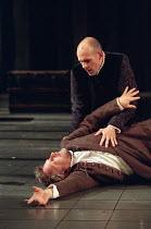 Hamlet dies: Simon Russell Beale (Hamlet, Prince of Denmark), Simon Day (Horatio) in  HAMLET by Shakespeare at the Lyttelton Theatre, National Theatre (NT), London SE1: first night 05/09/2000   design...