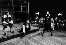 BARTHOLOMEW FAIR  by Ben Jonson  set design: Robin Don & Tanya McCallin  costumes: Lindy Hemming  lighting: Leonard Tucker  director: Peter Barnes front, l-r: John Wells (Bartholomew Cokes), Henry Woo...
