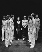 AGAMEMNON by Aeschylus adapted and directed by Steven Berkoff lighting: John Gorringe <br> rear centre: Deborah Norton (Clytemnestra), Steven Berkoff (Agamemnon) with male Chorus (front left: Hilton M...