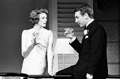 PRIVATE LIVES by Noel Coward set design: Anthony Powell costumes: Beatrice Dawson lighting: Joe Davis director: John Gielgud <br> Maggie Smith (Amanda Prynne), Robert Stephens (Elyot Chase) Queen's Th...