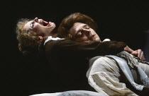 AMADEUS by Peter Shaffer design & lighting: John Bury director: Peter Hall <br> Mozart dies: Morag Hood (Constanze Weber), Richard O'Callaghan (Wolfgang Amadeus Mozart) a National Theatre (NT) 1979 pr...