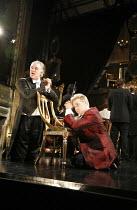 AMADEUS  by Peter Shaffer  director & designer: John Doyle ~l-r: Matthew Kelly (as Antonio Salieri), Jonathan Broadbent (as Wolfgang Amadeus Mozart) ~Wilton's Music Hall, London E1  18/09/2006 ~(c) Do...