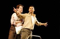 LA BOHEME   by Puccini - conductor: David Parry   director: Francesca Zambello ~l-r: Mark Stone (Marcello), Victor Ryan Robertson (Rodolfo) ~Royal Albert Hall, London   23/02/2006 (cast 'A') ~(c) Dona...