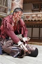 CORIOLANUS   by Shakespeare   director: Dominic Dromgoole,l-r: Jonathan Cake (Coriolanus), Mo Sesay (Aufidius),Shakespeare^s Globe, London SE1                     10/05/2006,