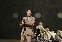 'THE DEATH OF KLINGHOFFER' (music: John Adams   libretto: Alice Goodman   conductor: Edward Gardner   director: Anthony Neilson),Darren Abrahams (Molqi)) with (in wheelchair) Jonathan Summers (Leon Kl...