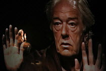EH JOE   by Samuel Beckett   director: Atom Egoyan,Michael Gambon (Joe) with his image projected on gauze across the front of the stage,Gate Theatre, Dublin production   Duke of York^s Theatre, London...