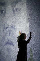 THE FLYING DUTCHMAN (Der Fliegende Hollander) by Wagner   ,conductor: Carlo Rizzi   director: David Pountney,Annalena Persson (Senta) with the Dutchman's projected image (Bryn Terfel),Welsh National O...