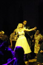 HE HAD IT COMING (a new version of DON GIOVANNI)   by Mozart   conductor: William Lacey   director: Graham Vick,Lord Giovanni abuses Zerlina: Rodney Clarke, Susan Atherton,Birmingham Opera Company / B...