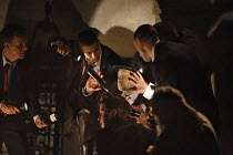 HE HAD IT COMING (a new version of DON GIOVANNI)   by Mozart   conductor: William Lacey   director: Graham Vick,Lord Giovanni (Rodney Clarke, centre, disguised) confuses his pursuers,Birmingham Opera...