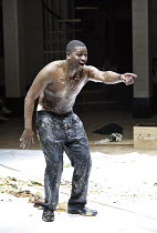 Act 2, supper scene - Lord Giovanni (Rodney Clarke) spattered with food in HE HAD IT COMING (a new version of DON GIOVANNI by Mozart) at the Birmingham Opera Company, Birmingham, England  15/03/2006 ~...