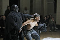 HE HAD IT COMING (a new version of DON GIOVANNI)   by Mozart   conductor: William Lacey   director: Graham Vick,final scene - justice catches up with Lord Giovanni - l-r: Keel Watson (the Commendatore...