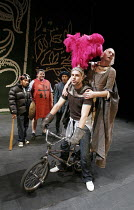 THE KNIGHT OF THE BURNING PESTLE   by Francis Beaumont   director: Anna Mackmin,on bike, l-r: Rafe Spall (Rafe), Tim Potter (Mistress Merrythought),Mercury Theatre / Young Vic / BITE:05 co-production...