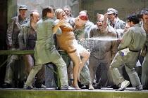 LADY MACBETH OF MTSENSK   by Shostakovich   conductor: Antonio Pappano   director: Richard Jones,workers abuse Aksinya: Carole Wilson (Aksinya),The Royal Opera / Covent Garden   London WC2         30/...