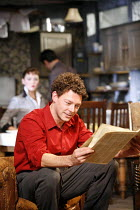 LOOK BACK IN ANGER   by John Osborne   director: Peter Gill ~Richard Coyle (Jimmy Porter), (in background) Rachael Stirling (Helena Charles) ~Theatre Royal Bath / Bath, England  22/08/2006