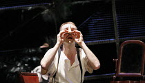 THE NOSE   by Dimitri Shostakovich   conductor: Patrick Bailey   director: John Fulljames,Kovalyov tries to refit his nose: Jeremy Huw Williams (Kovalyov),The Opera Group / Brighton Festival / Brighto...