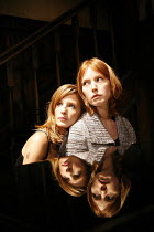 PIANO/FORTE   written & directed by Terry Johnson,reflected in piano lid - l-r: Kelly Reilly (Louise), Alicia Witt (Abigail),Jerwood Theatre Downstairs / Royal Court Theatre, London SW1  20/09/2006,