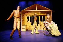 PINOCCHIO by Trish Cooke (book & lyrics) and Robert Hyman (music & lyrics)   director: Kerry Michael,l-r: Richard Sumitro (Pinocchio), (peering through window) Jo Melville (Jam Cricket), Larrington Wa...