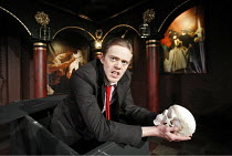 THE REVENGER^S TRAGEDY   by Middleton   in a new version by Meredith Oakes   director: Gavin McAlinden,Kris Marshall (Vindici) with the skull of Gloriana, his poisoned wife,Southwark Playhouse, London...