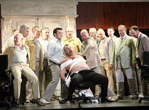 RIGOLETTO   by Verdi   conductor: Martin Andre   director, set & lighting designer: Charles Edwards,Monterone bound and about to be beaten: (in chair) Stephen Richardson (Monterone),Opera North / Leed...