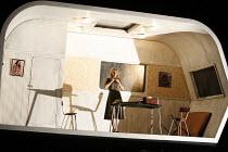 RIGOLETTO   by Verdi   conductor: Martin Andre   director, set & lighting designer: Charles Edwards,I/ii - Gilda in her caravan home: Henriette Bonde-Hansen (Gilda),Opera North / Leeds, England      0...