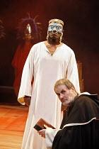 THE ROYAL HUNT OF THE SUN   by Peter Shaffer   director: Trevor Nunn,(rear) Paterson Joseph (Atahuallpa, Sovreign Inca of Peru), (kneeling) Oliver Cotton (Fray Vincente de Valverde),Olivier Theatre /...