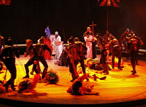 THE ROYAL HUNT OF THE SUN   by Peter Shaffer   director: Trevor Nunn,Act I/sc.12 - The Massacre - rear centre: Paterson Joseph (Atahuallpa, Sovreign Inca of Peru),Olivier Theatre / National Theatre, L...