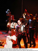 THE ROYAL HUNT OF THE SUN   by Peter Shaffer   director: Trevor Nunn,Act I/sc.12 - The Massacre: (bottom left, kneeling) Paterson Joseph (Atahuallpa, Sovreign Inca of Peru), ,(behind, with cross) Oliv...