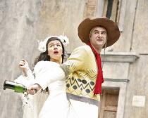 THE TAMING OF THE SHREW   by Shakespeare   director: Rachel Kavanaugh,III/ii - Sirine Saba (Katherina), John Hodgkinson (Petruchio),Open Air Theatre / Regent^s Park, London NW1           05/06/2006...