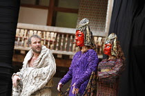 TITUS ANDRONICUS   by Shakespeare   director / ^Master of Play^: Lucy Bailey,V/ii - l-r: Douglas Hodge (Titus Andronicus), Geraldine Alexander (Tamora), Richard Riddell (Chiron),Shakespeare^s Globe, L...