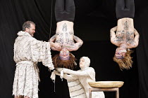 TITUS ANDRONICUS   by Shakespeare   director / ^Master of Play^: Lucy Bailey,V/ii - l-r: Douglas Hodge (Titus Andronicus), Richard Riddell (Chiron), Laura Rees (Lavinia), Sam Alexander (Demetrius),Sha...
