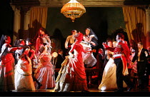LA TRAVIATA   by Verdi   conductor: Jonathan Darlington   director: Conall Morrison,Act II sc.ii - the party,new production supported by Culture Ireland / English National Opera / London Coliseum  WC2...