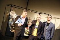 FAUSTUS   by Christopher Marlowe   adapted by Rupert Goold & Ben Power    director: Rupert Goold ~l-r: Mark Lockyer (Foster), Stephen Noonan (Jake Chapman), Jonjo O'Neill (Dinos Chapman)~in associatio...