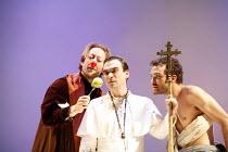 FAUSTUS   by Christopher Marlowe   adapted by Rupert Goold & Ben Power    director: Rupert Goold ~l-r: Scott Handy (Dr John Faustus), Jason Morell (The Pope), Jake Maskall (Mephistopheles) ~in associa...