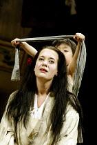 'MADAM BUTTERFLY' (Puccini)~Sorrow blindfolds his mother: Koji Takahashi (Sorrow), Julia Melinek (Cio-Cio-San/Butterfly)~English National Opera/London Coliseum., WC2                    11/05/2002