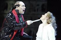 'THE MAGIC FLUTE' (Mozart - conductor: Nicholas Kraemer   original director: Nicholas Hytner)~Alasdair Elliott (Monostatos), Carolyn Sampson (Pamina)~English National Opera / London Coliseum  WC2...