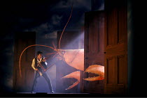 'THE MAGIC FLUTE' (Mozart - conductor: Jean-Yves Ossonce   director: Dominic Cooke),opening scene, Tamino fights the 'serpent' (lobster in this production): Peter Wedd (Tamino),Wales Millennium Centre...